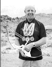 The author with a Groves/Merlin Flight bow in Nevada, 1997